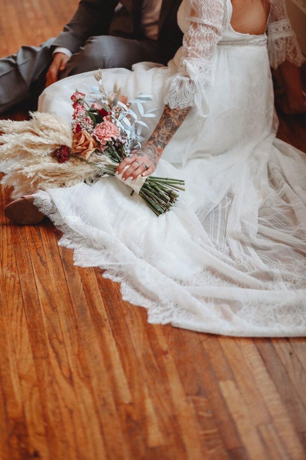 bride and groom sitting on floor